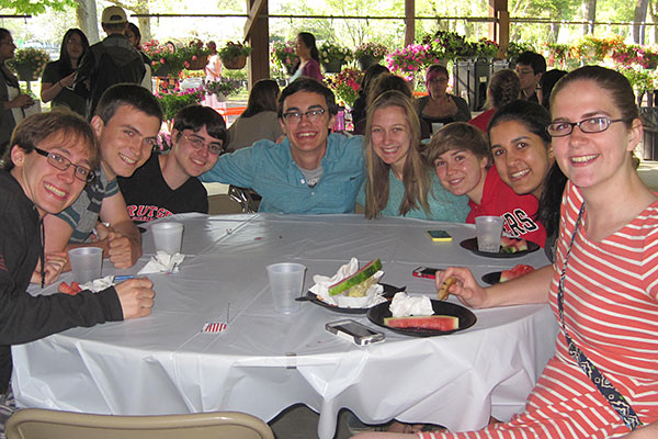 Eight students gathered around a table.